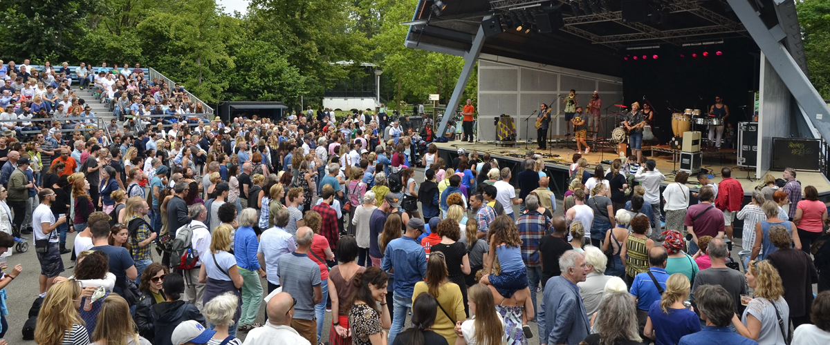 Amsterdam, Netherlands - August 6, 2016: The Tentempies band in the Open Air Theater (Openluchttheater) in the Vondelpark with spectators in the foreground
